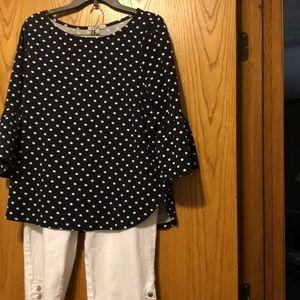 Adorable bell sleeved navy/ white polka dot top.